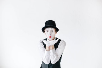 Mime with red lips sends an air kiss