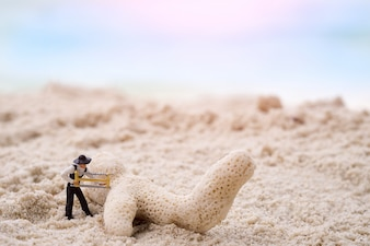 Miniature engineer of construction workers with coral.Vintage tone. Retro filter effect, soft focus, low light.(selective focus)