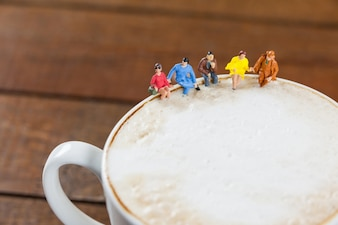 Miniature group of friends having coffee