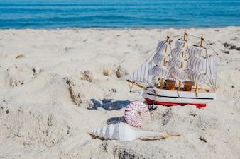 Miniature of ship on tropical beach