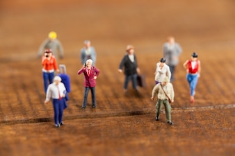 Miniature people travelling