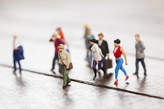 Miniature people travelling