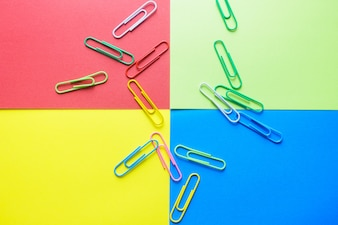 Minimal work space - Creative flat lay photo of workspace desk with paperclips on copy space pastel background. Top view , flat lay photography.