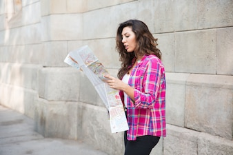 Misunderstanding girl looking at map of city
