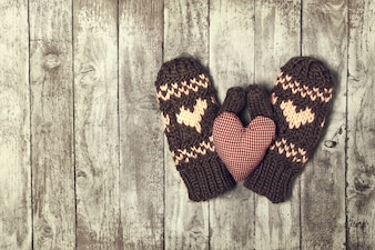 Mittens with hearts and a plush heart