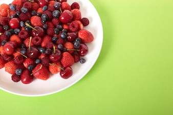 Mixed berries on white plate