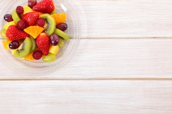 Mixed fresh fruits on a wooden table