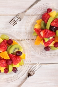 Mixed fresh fruits salad with forks