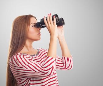 Model looking through binoculars