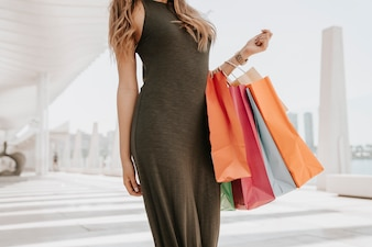 Model posing with bags after a shopping day