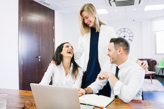 Modern business people laughing