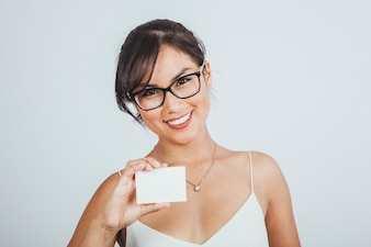 Modern businesswoman with business card