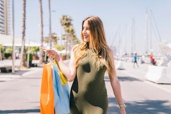 Modern woman at shopping pointing something
