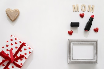 Mom lettering, lipstick, frame, gift box and heart