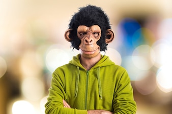 Monkey man with his arms crossed  on unfocused background