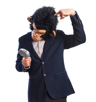 Monkey man with magnifying glass