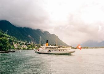 MONTREUX, SWITZERLAND - AUGUST 13, 2014: Cruise boat La Suisse on Lake Geneva in Montreux, Switzerland. Paddle steamer La Suisse built in 1910.
