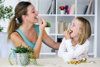 Mother and daughter eating trinkets