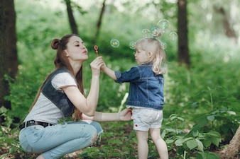 Mother and daughter making soap bubbles