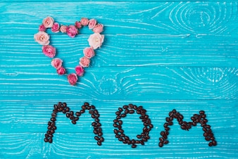Mother's day composition with flowers and coffee beans