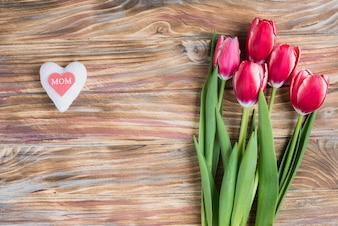 Mother's day composition with heart and beautiful flowers