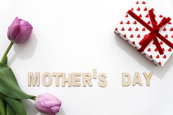 Mother's day lettering with two roses