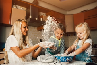 Mother throwing flour on her children
