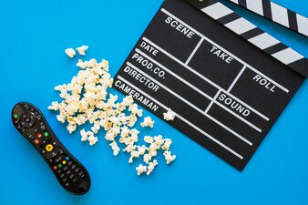Movie concept with clapperboard and remote control