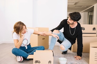 Moving concept with couple on floor