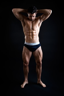Muscular man in underwear posing in studio