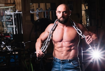 Muscular man posing with chain