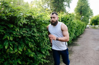 Muscular man running outdoors