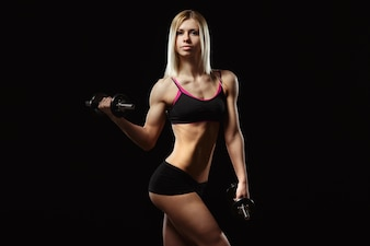 Muscular woman lifting a weight