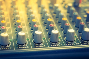 Music mixer desk with various knobs ( Filtered image processed v