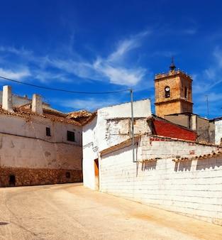Narrow street in old town. El Toboso