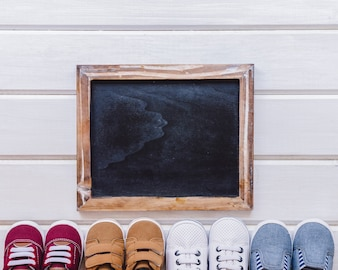 Newborn concept with slate and shoes