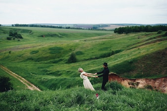 Newly married couple on a green field