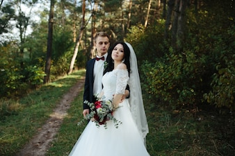 Newlywed couple in woods