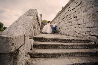 Newlyweds down some stairs