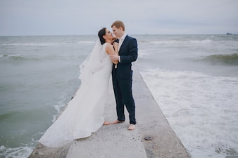 Newlyweds kissing in the sea