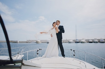 Newlyweds over a boat