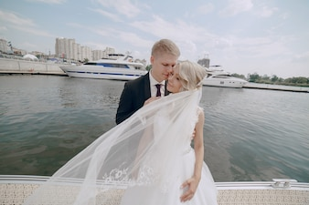 Newlyweds posing with the pier background