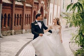 Newlyweds walking through the village