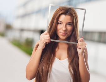 Nice female model holding photo frame