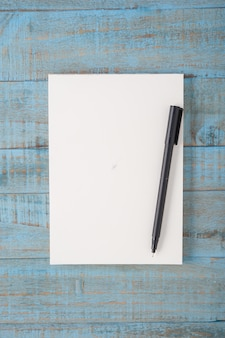Notebook on blue wood table