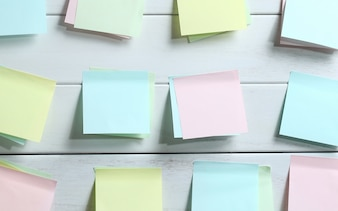 Notepapers sticked on white wooden board