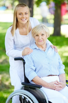 Nurse with elderly woman in wheelchair