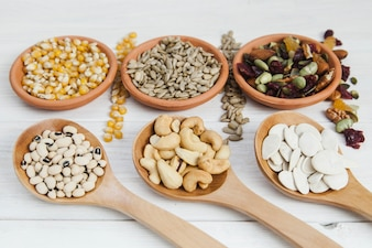 Nuts and seeds in laddles and bowls