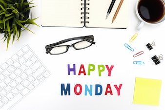 Office desk table with happy monday word