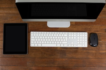 Office desk with computer and digital tablet